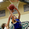 Longmont's Eli Sullivan (23) shoots over D'Evelyn's Cody Marvel (4) during the game at D'Evelyn High School on Saturday, March 2, 2013. Longmont lost to D'Evelyn 72-58. For more photos visit www.BoCoPreps.com. (Greg Lindstrom/Times-Call)