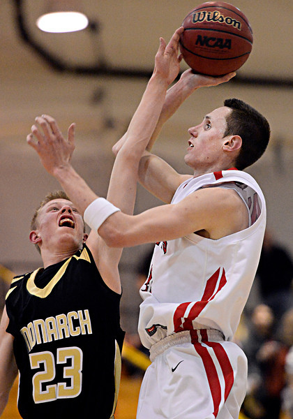 Fairview's Austin Sparks (41) has a shot blocked by Monarch's Shawn Kirkman (23) during the game at Fairview High School on Thursday, Feb. 21, 2013. Fairview beat Monarch 60-51 to clinch the Front Range League title. For more photos visit www.BoCoPreps.com. (Greg Lindstrom/Times-Call)