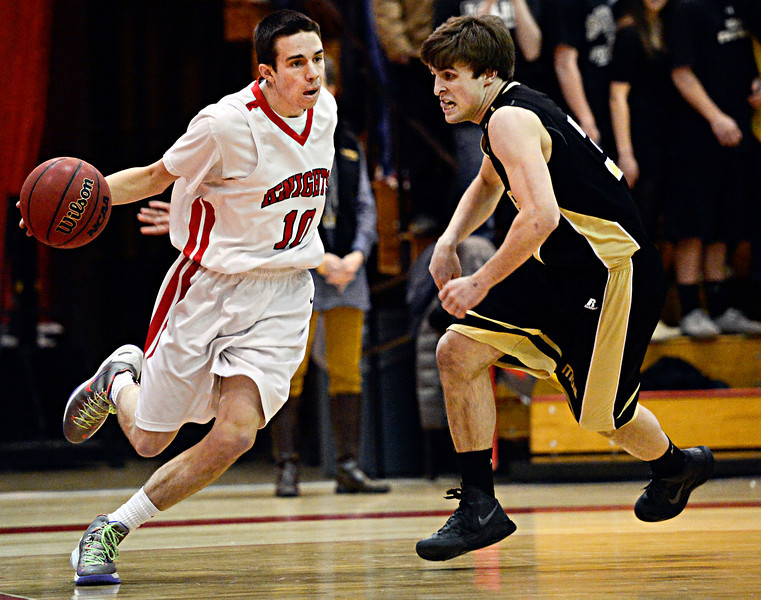Fairview's Trevor McQueeney (10) drives past Monarch's Jay MacIntyre during the game at Fairview High School on Thursday, Feb. 21, 2013. Fairview beat Monarch 60-51 to clinch the Front Range League title. For more photos visit www.BoCoPreps.com. (Greg Lindstrom/Times-Call)