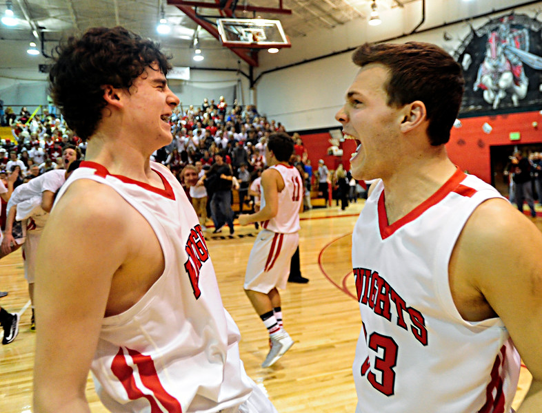 Fairview's Gabe Tierney, left, and Alex Waters, right, celebrate after the game at Fairview High School on Thursday, Feb. 21, 2013. Fairview beat Monarch 60-51 to clinch the Front Range League title. For more photos visit www.BoCoPreps.com. (Greg Lindstrom/Times-Call)