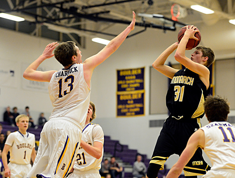Monarch's Ben Beauchamp (31) shoots over Boulder's Jonah Charnick (13) during the game at Boulder High School on Tuesday, Jan. 8, 2013. Monarch beat Boulder 51-49. For more photos visit www.BoCoPreps.com. (Greg Lindstrom/Times-Call)