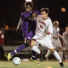 Scarborough senior Sam Ware fights off Deering senior Yannick Sendama.