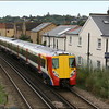 South West Trains class 458 (458011) is seen about to enter Egham Station with 2C94 (0956 Reading-London Waterloo) - 10 July 2014.