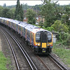 A pair of South West Trains class 450 units (450114 & 450556) heads towards Egham Station with 2C28 (1033 Weybridge-London Waterloo) - 10 July 2014.