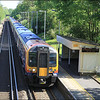 A 12-car South West Trains, with class 450 (450545) leading, makes it stop at Milford (Surrey) with 2P21 (0916 London (Waterloo)-Haslemere) - 19 May 2014.