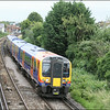 South West Trains high capacity class 450 (450552) leaves Egham with 2S23 (0952 London Waterloo-Weybridge service) - 10 July 2014.