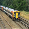 A South West Trains class 159 (159101), together with a class 158 (158883), form 1L24 (0722 Yeovil Junction-London (Waterloo)) as they pass Pot Bridge (near Winchfield) - 23 July 2014.