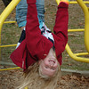Amesbury: Rosie Costello, 7, hangs around on the monkey bars at the Cashman School yesterday morning. She was at recess which buzzing with activity at the weather was unseasonably warm. Bryan Eaton/Staff Photo