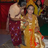 Woman Pinning Money On Dancer<br /> Nat Festival<br /> Hintha Gon Shrine<br /> <br /> Bago, Burma<br /> 25 December 2012
