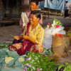 Vegetable And Flower Vendor Enjoying Her Job<br /> Downtown Market<br /> <br /> Nyaung Shwe, Burma<br /> 3 November 2012