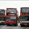 Making its way between two Wilts & Dorset Optare Spectras, Volvo 412 (HF05GGX) heads out of Lymington Bus Station on service X12 to Bournemouth - 6 November 2008.