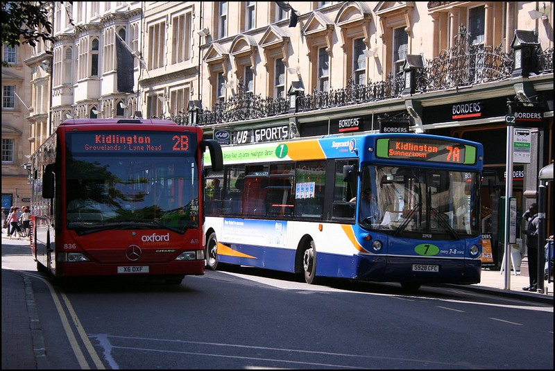 Go-Ahead Oxford Mercedes Citaro 836 (X6OXF) passing a Stagecoach Oxford Volvo in Magdalen Street, Oxford, whilst working service 2B to Kidlington – 2 June 2007.