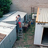Brian built two garden sheds with a space between. Here Craig the Builder, puts a roof over that handy space. After the big Buffalo shed is completed, Vic Mabin cranes will do a tricky move  to lift the ATCO donga completely over the very top of our little two bedroom house. Photos of this operation follow later.