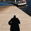 Male shadow on slipway in front of car ferry