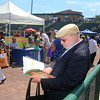 Lowell Spinners Job Fair at LeLacheur Park, with about 40 area employers welcoming prospective job applicants. Steven Howard of Burlington, who's looking for an IT or engineering job, looks over materials he'd collected so far. (SUN/Julia Malakie)