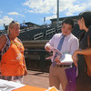 Lowell Spinners Job Fair at LeLacheur Park, with about 40 area employers welcoming prospective job applicants. Cindy Perella of Haverhill, who works at the Tewksbury Home Depot, provides information to Jason Zeng of East Providence, a recent Johnson & Wales graduate who is looking for an entry level management job. His wife Donna Dong is at right. (SUN/Julia Malakie)