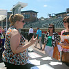 Lowell Spinners Job Fair at LeLacheur Park, with about 40 area employers welcoming prospective job applicants. From left, Alina Karle of Nashua, an HR recruiter for Axis Communications, Inc. of Chelmsford, talks to Pamela Swinimer of Nashua and Lisa Weber of Hudson, N.H. Axis Communications does security systems, cameras and access control. (SUN/Julia Malakie)7