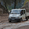 Pick-Up Truck driving on muddy Road - Flood Disaster in Olympos, Turkey, Asia