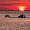 Sunset Patrol Patrol boats on duty in the Chesapeake Bay captured during a dramatic blood red sunset.