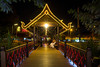 An illuminated bridge at night near the Night Market in Siem Reap, Cambodia, Asia.