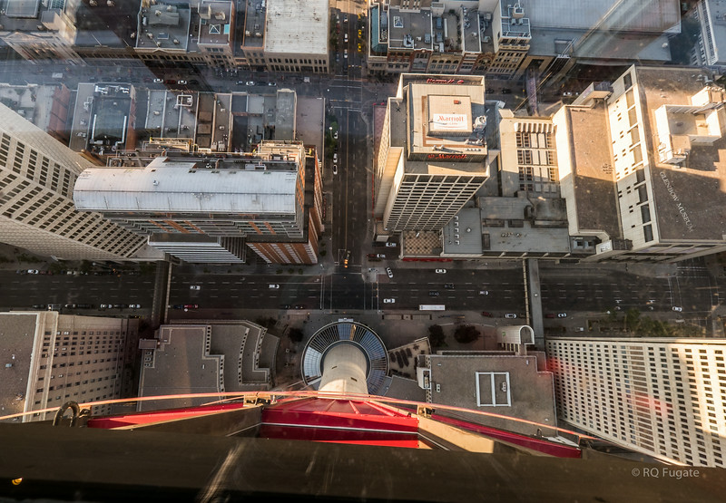 View looking down through the glass floor in Calgary Tower.