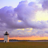 Billowing clouds fill the daybreak sky over the  Long Point Lighthouse, Cape Cod National seashore, Provincetown, Massachusetts