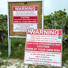 Warning signs near Dean's Blue Hole in Long Island, Bahamas