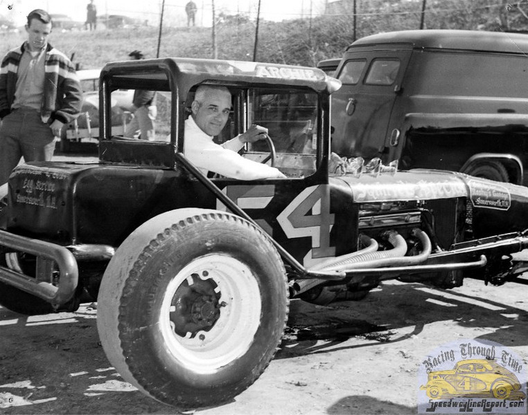 BONUS SHOT: Just another cool image from our archives of our pal, R.A. Silvia…. Seen here ready-to-roll in one of his signature #54 creations is racer Archie Archambault, Another of the premier players in the birth of the New England Super Modified, note that the machines of Oscar Ridlon's URDC circuit had become full-blown race cars by the time this image was captured displaying little resemblance to the earlier coupes. I'm betting that guiding one of these beasts around Hudson or The Pines was indeed, a handful! (Photo Courtesy R.A. Silvia Archives).