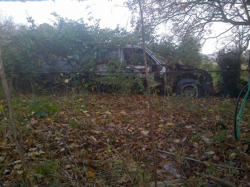 December 2013. Second is this silver saloon car, I am fairly sure it is what is left of an early 1980s Mazda 626 or Montrose, the photo makes identification harder than trying to peer through the bushes.