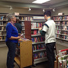 Colin and his aid, Judy, help with shelving at CSD as part of Colin's work experience. December 2013