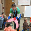 Pam gets a child involved in the stories and activities  during Family Storytime at CSD, 05/29/14.