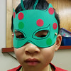 A boy shows off his superhero mask at Castle Down's Masks of Mystery program.  31/3/2014