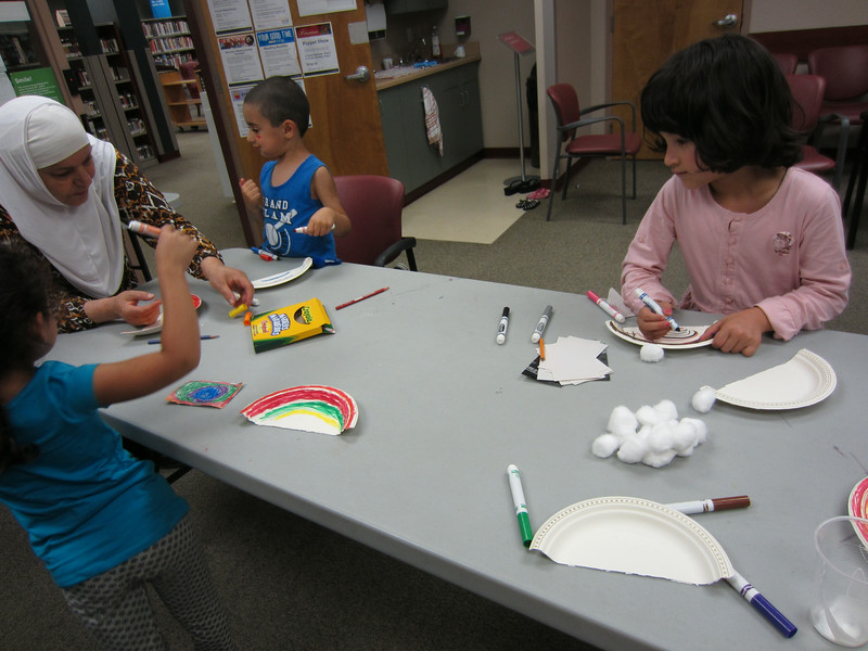 Some kids decorating their own rainbows.