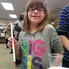A young wizard shows off her new magic wand created during CSD's Tricks of Wizards program.  1/4/2014