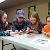 A group of young wizards-in-training learn some magic card tricks to amaze and astound their friends at CSD's Tricks of Wizards program. 1/4/2014