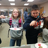 Two young wizards show off their new wands and brew a magical potion or two at CSD's Tricks of Wizards program. 1/4/2014