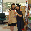 EPL staff members dress up for Halloween: Laura as the Paperbag Princess and Stacey as a graduate.