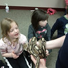 Kids have the chance to touch a snake during a visit from the Valley Zoo.