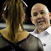 Georgia assistant coach Jay Hogue talks with Georgia gymnast Brittany Rogers during a NCAA gymnastics meet in Athens, Ga., Saturday, March 9, 2013. (Evan Stichler, evansan8@gmail.com)