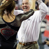 Georgia assistant coach Jay Hogue congratulates Georgia gymnast Brittany Rogers during a NCAA gymnastics meet in Athens, Ga., Saturday, March 9, 2013. (Evan Stichler, evansan8@gmail.com)
