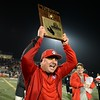Redlands East Valley High School head coach Kurt Bruich raises the championship plaque after defeating Riverside Poly High School 36-33 to win the CIFSS Inland Division title game on Friday, December 5, 2014 at Ramona High School in Riverside, Ca. (Photo by Micah Escamilla/Redlands Daily Facts)