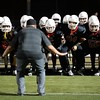 Redlands East Valley High School head football coach Kurt Bruich, center, leads his team onto the field during a game against Eisenhower High School on Friday, October 10, 2014 at Citrus Valley High School in Redlands, Ca. REV won the game 64-0. (Micah Escamilla/Redlands Daily Facts)