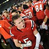 Redlands East Valley High School's Carter Flowers, center, and Brock Pritchett, right, celebrate after defeating Clayton Valley Charter 34-33 in the CIF-State Division II championship on Saturday, December 20, 2014 at StubHub Center in Carson, Ca. (Photo by Micah Escamilla/Redlands Daily Facts)