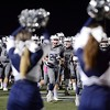 The Redlands High School football team makes their way onto the field during a game against Carter High School on Thursday, October 30, 2014 in Redlands, Ca.  (Photo by Micah Escamilla/Redlands Daily Facts)