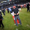 Redlands East Valley High School head football coach Kurt Bruich hugs his father Dick Bruich after REV defeated Clayton Valley Charter 34-33 in the CIF-State Division II championship on Saturday, December 20, 2014 at StubHub Center in Carson, Ca. (Photo by Micah Escamilla/Redlands Daily Facts)