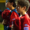 Michael bowers, 10, and teammate Kody Davis, 10, during the singing of the National Anthem at  Upland Foothill Little League during opening night, at San Antonio Park in Upland, on Friday, March 7, 2014. (Photo by Frank Perez for the Inland Valley Daily Bulletin)