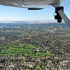 An aerial view of the Redlands Country club is seen from the Air Support Unit of the Redlands Police Department, a 1967 Cessna 172, on Friday, March 20, 2015 in Redlands, Ca. (Micah Escamilla/Redland Daily Facts)