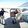 Senior Tactical Officer Wayne Reid, left, chats with pilot Carl Rossi next to the Air Support Unit of the Redlands Police Department, a 1967 Cessna 172, on Friday, March 20, 2015 at Redlands Municipal Airport in Redlands, Ca. (Micah Escamilla/Redland Daily Facts)