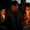 Stephen Barber, center, father 22-year-old missing student, Sahray Barber, embraces his wife and daughter during a candlelight vigil on Friday, March 13, 2015 at the Art Institute of California Inland Empire in San Bernardino, Ca.  (Photo by Micah Escamilla/The Sun)