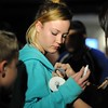 Brianna Berg, 14, center, has a button pinned on her by her mother, Dawn, during a candlelight vigil for missing student, Sahray Barber, 22, is held on Friday, March 13, 2015 at the Art Institute of California Inland Empire in San Bernardino, Ca. The Berg family have been friends of Barber for years. (Photo by Micah Escamilla/The Sun)